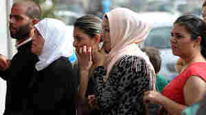 Syrian citizens line up to apply for visas outside the German embassy in Beirut. Lebanon hosts more than 1 million Syrian refugees.