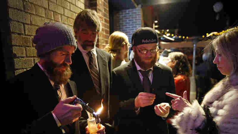 Partygoers attend a Prohibition-era themed New Year's Eve party celebrating the start of retail pot sales, at a bar in Denver on Dec. 31, 2013.