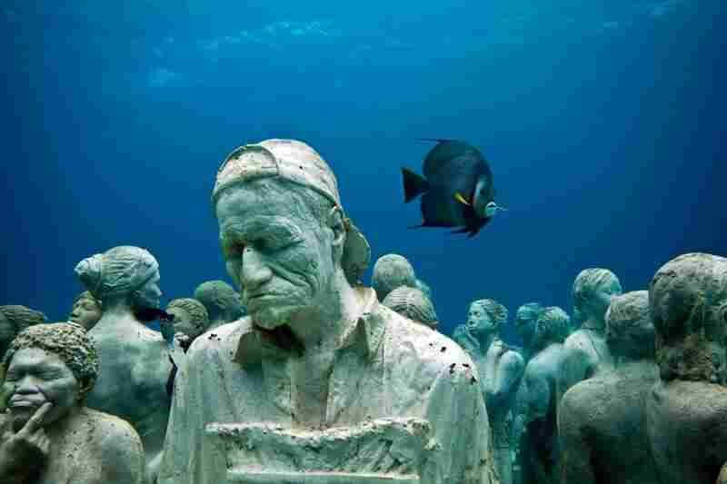 The Silent Evolution, by Jason deCaires Taylor, off the coast of Cancun, Mexico.