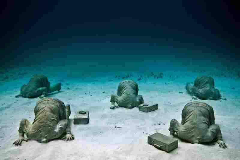 The Banker, by Jason deCaires Taylor, off the coast of Cancun, Mexico.