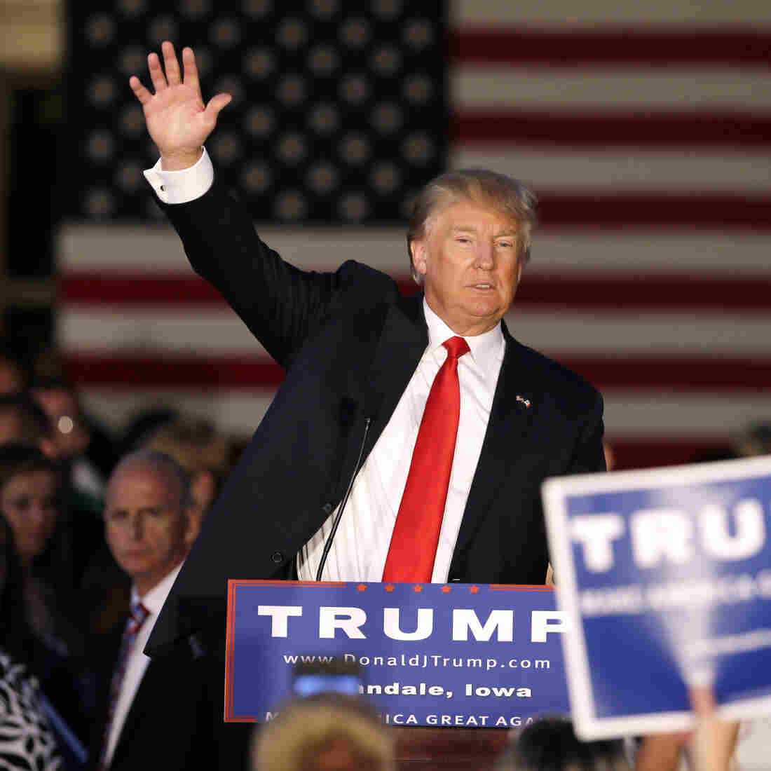 Donald Trump waves at the end of a rally at Urbandale High School, in Urbandale, Iowa, on Sunday.