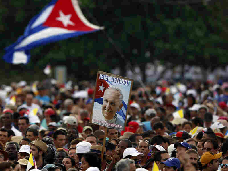 Faithful wait for the arrival of Pope Francis for a Mass in Revolution Plaza in Havana, Cuba, Sunday.