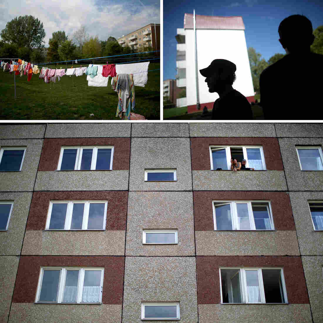 Syrian refugees look out of the windows of the Pentagon apartments, where they are temporally being housed in New Hardenberg, Germany.