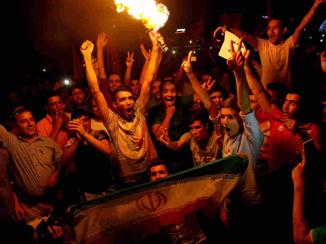Iranians cheer during street celebrations July 14 in Tehran, Iran, following a landmark nuclear deal. Many young Iranians want their country to open to the world, and see the nuclear agreement as an important step in ending Iran's isolation.