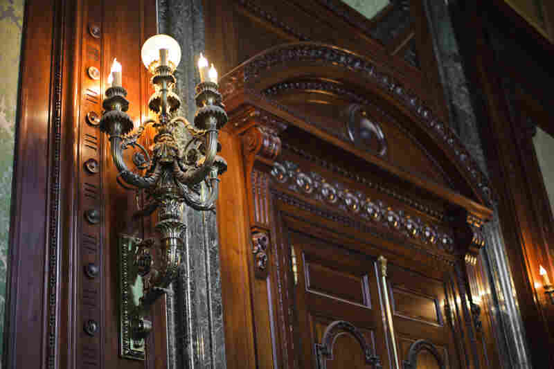 Ornate woodwork, granite moldings and antique chandeliers gleam like new.