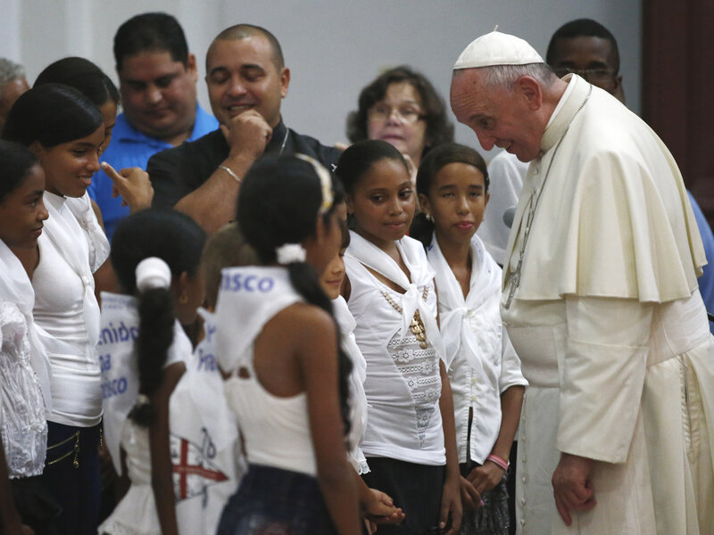 Pope Francis talks with a group of children in the sanctuary of the Virgin of Charity of Cobre, in El Cobre, Cuba, Monday, Sept. 21, 2015. (Tony Gentile/AP)