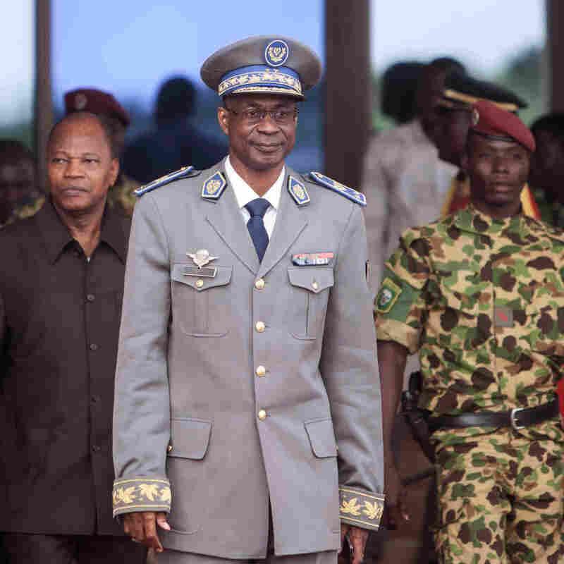 Burkina Faso coup leader Gen. Gilbert Diendere waits for Senegal President Macky Sall to arrive at the airport for talks in Ouagadougou, Burkina Faso, last week.