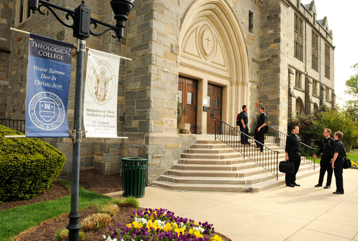 Seminarians greet each other outside Theological College, the national seminary of The Catholic University of America in Washington, D.C. (Ed Pfueller/Courtesy of The Catholic University of America)