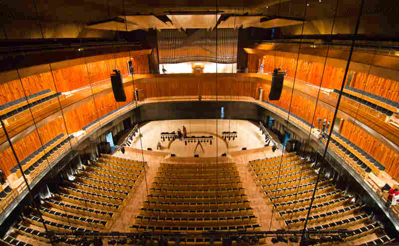 The Blue Whale auditorium (pictured still under construction) seats 1,750 in three tiers, with a stage suitable for symphony concerts backed by a pipe organ.