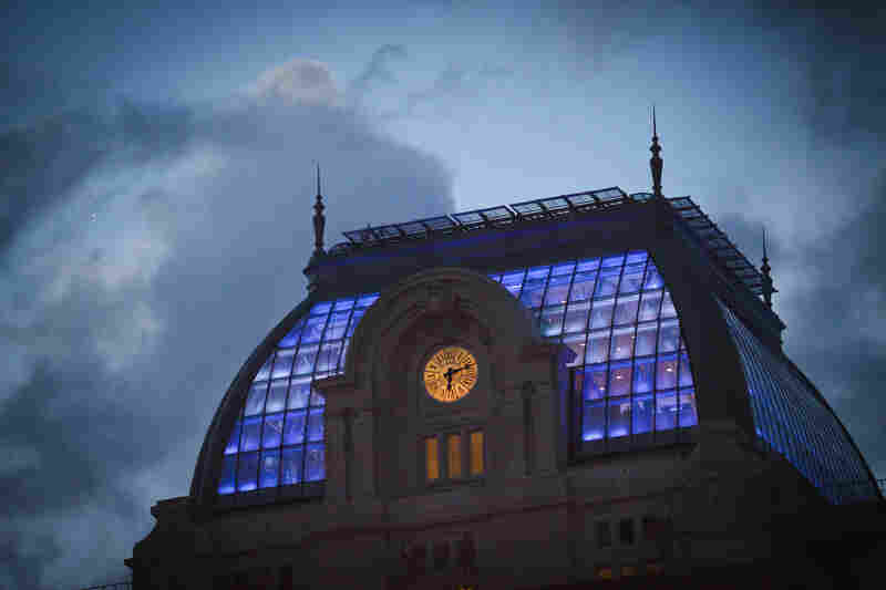 The glass dome is now lit from within and will soon house a restaurant for patrons of the center.