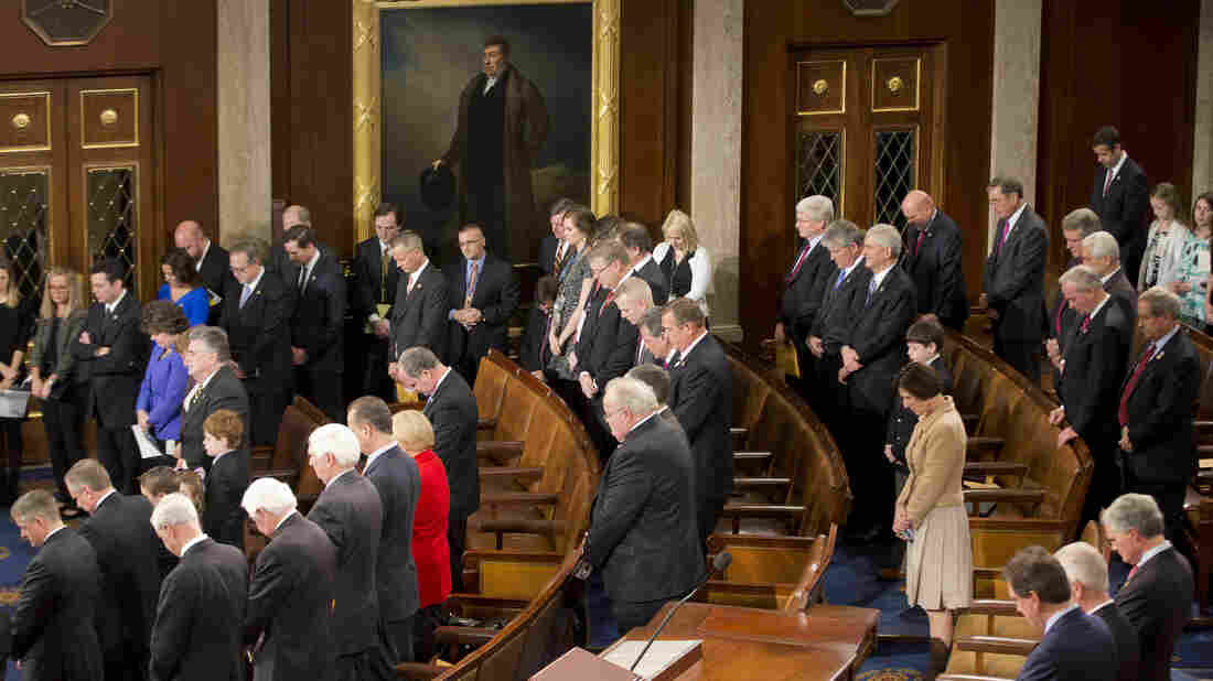 Members of the House of Representatives bow their heads for a prayer as they gather for opening session of the 114th Congress in January.