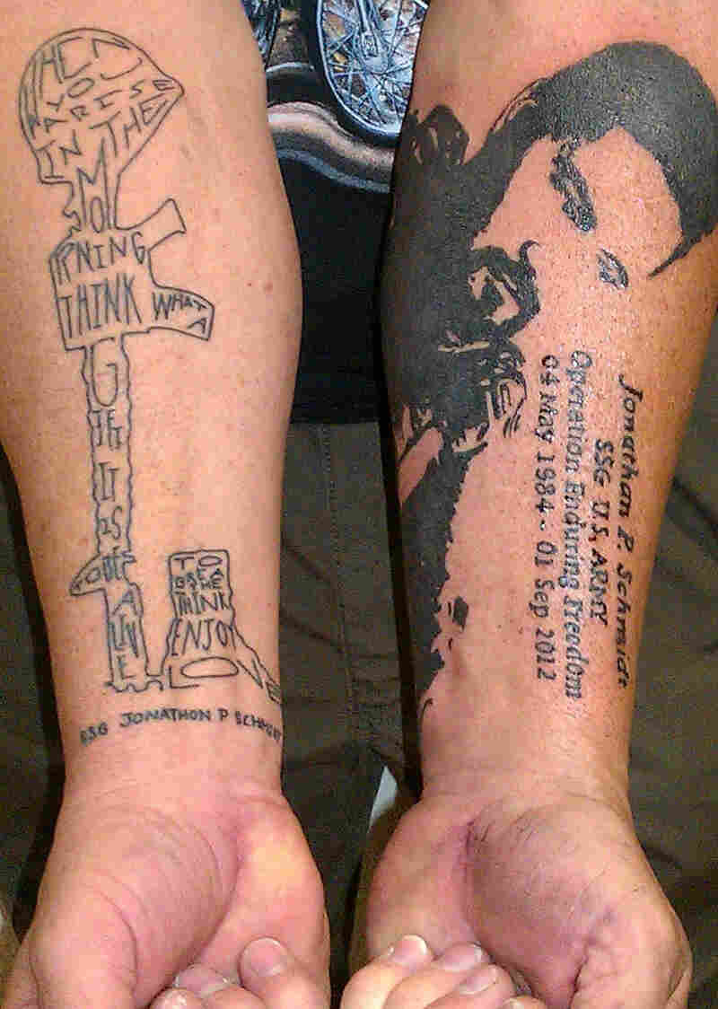 Phil Schmidt shows two of the five tattoos he has received to pay tribute to his son Jonathan, who was killed in Afghanistan three years ago.