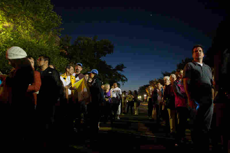 Crowds gather in the early morning hours near the eastern entrance of the Ellipse for the papal parade.