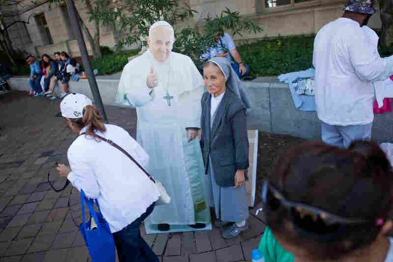 A cutout of Pope Francis attracted people who wanted their picture taken with the pontiff.