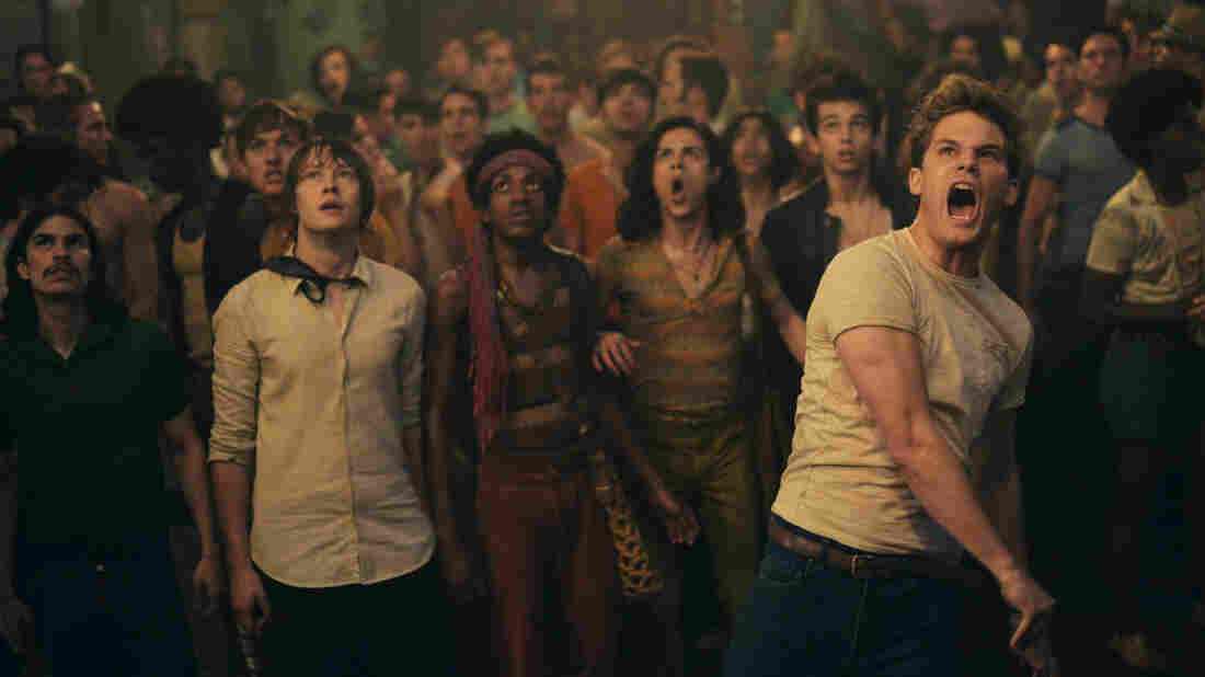 In Stonewall, actor Jeremy Irvine (right) plays a fictional high school student from Indiana who throws the brick that starts the Stonewall riots.