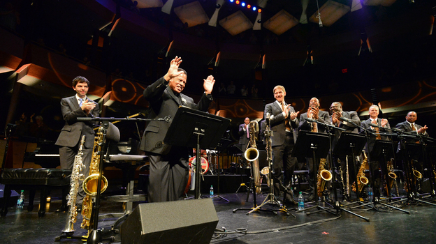 Jazz legend Wayne Shorter accepts the applause of the Jazz at Lincoln Center Orchestra during a retrospective of his music in May. (Jazz at Lincoln Center)