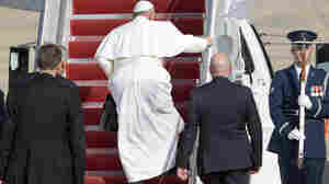 Pope Francis walks up the stairs at Andrews Air Force Base, Md., en route to New York, after visiting Washington where he spoke to a joint meeting of Congress and ate lunch with some 300 homeless people.