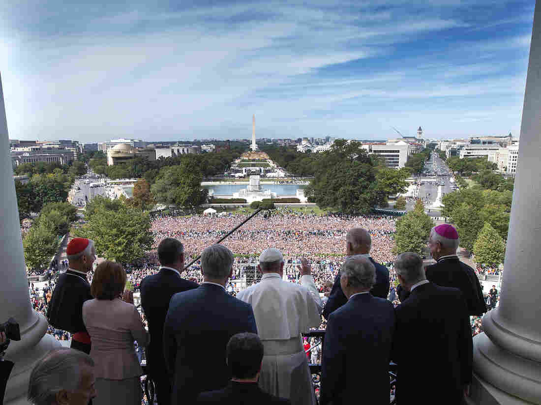Pope Francis, accompanied by members of Congress, waves to the crowd from the Speakers Balcony on Capitol Hill in Washington, on Thursday.