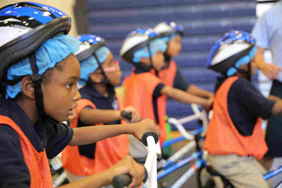 Lachae' Taylor gears up to ride in David Gesualdi's gym class at Walker-Jones Education Campus in Washington, D.C.