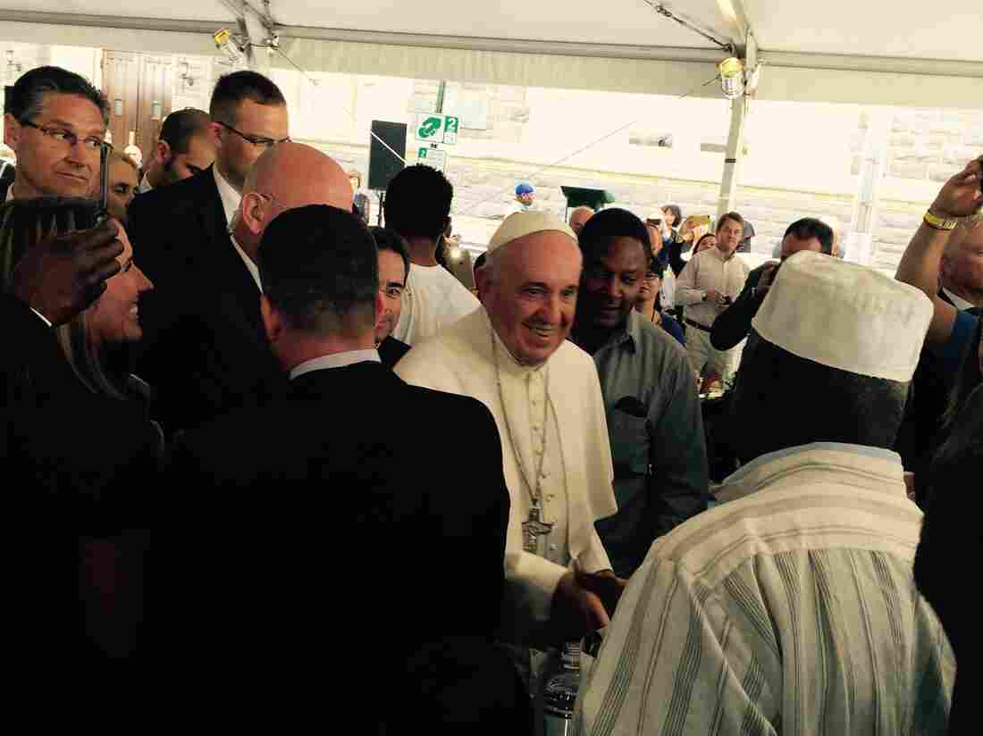 Pope Francis greets people at Catholic Charities in Washington, D.C., before having lunch with hundreds of low-income and homeless people.