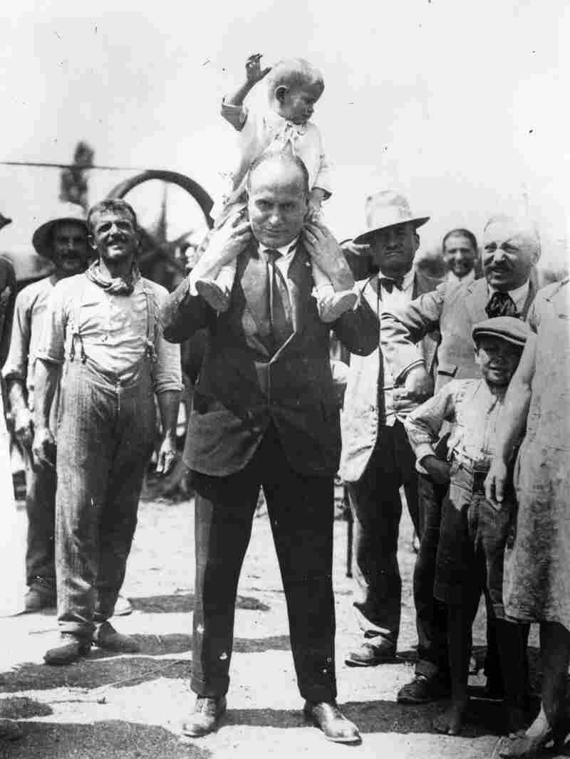 Italian dictator Benito Mussolini holds his son, Romano, on his shoulders in 1935. After his father died, Romano went on to become a jazz musician.