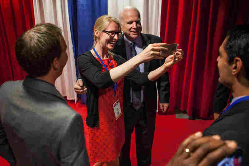 Senator John McCain spoke in the morning, and walked around the exhibit hall. Attendees stopped him while he walked to take photos with the senator from Arizona/former Presidential candidate at the summit.