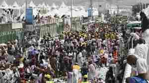 Muslim pilgrims and rescuers gather around people who were crushed by overcrowding in Mina, Saudi Arabia, during the annual hajj pilgrimage on Thursday.
