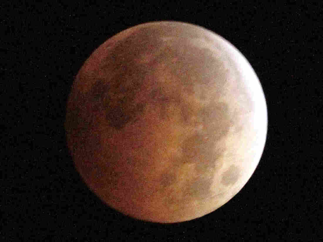 "An Oct. 8, 2014, photo shows the blood moon, created by the full moon passing into the shadow of Earth during a total lunar eclipse, as seen from Monterey Park, Calif. Sky-watchers will get a chance to see another ""blood moon"" eclipse on Sunday."