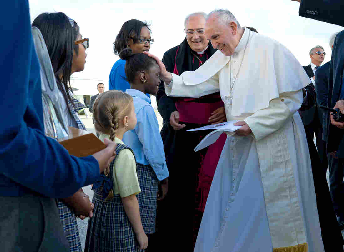 Pope Francis reaches out to 5th grader Omodele Ojo of East New York, Brooklyn during his arrival at John F. Kennedy International Airport on Thursday.