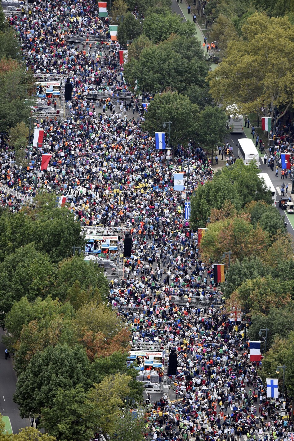 People gather on the Benjamin Franklin Parkway before the Papal Mass on Sunday in Philadelphia. (Michael Perez/AP)