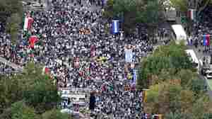 People gather on the Benjamin Franklin Parkway before the Papal Mass on Sunday in Philadelphia.