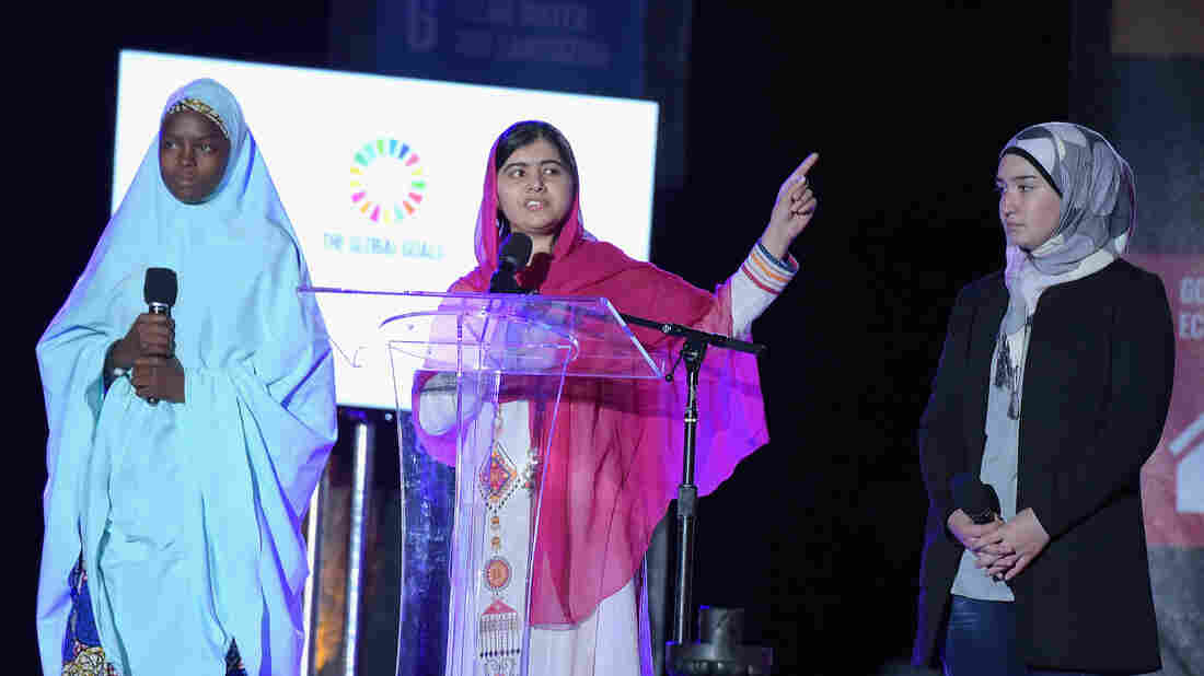 Activist Malala Yousafzai (center) speaks on stage at the 2015 Global Citizen Festival to end extreme poverty by 2030 in Central Park on Saturday in New York City.