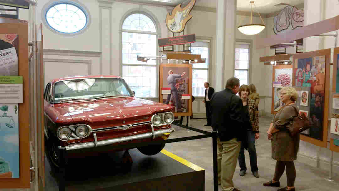 A Chevrolet Corvair is displayed among graphic illustrations of various landmark cases in the American Museum of Tort Law.