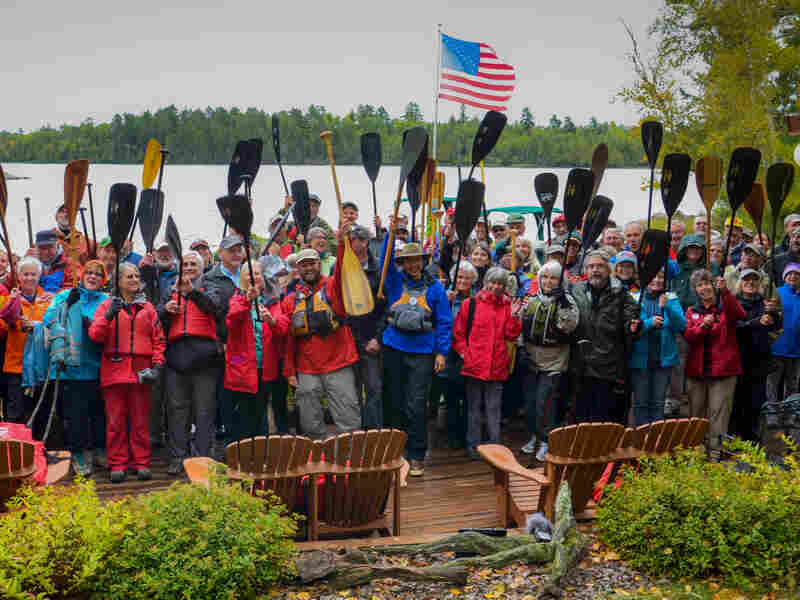 Amy and Dave Freeman's friends, family and supporters gather at River Point Resort and Outfitting Company in Ely, Minn., across from the proposed Twin Metals mine site, in preparation for the couple's launch on Sept. 23.