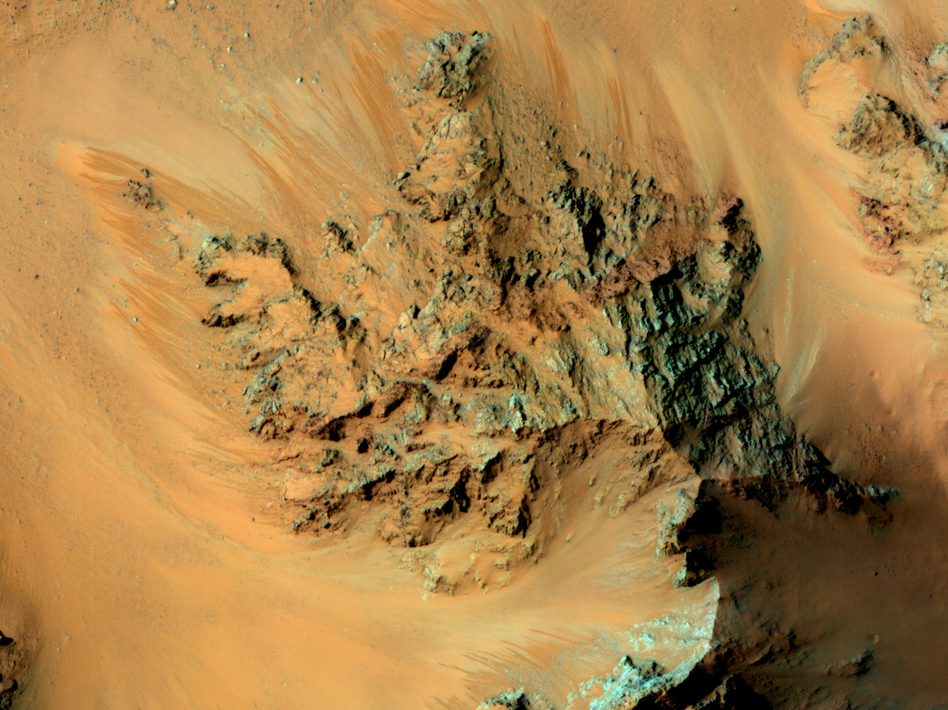 For several years, a satellite orbiting Mars has seen streaks flowing from Martian mountains during warm periods on the surface. Scientists have now confirmed that water is involved. (NASA/JPL/University of Arizona)