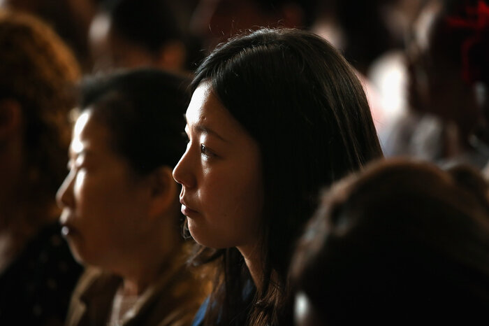 Jihye Jang of Korea participates in a naturalization ceremony at the Chicago Cultural Center on July 3, 2013 in Chicago, Illinois.