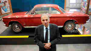 Consumer advocate Ralph Nader poses in front of a Chevrolet Corvair in the American Museum of Tort Law in Winsted, Conn. Nader featured the Corvair in his 1965 book on the auto industry's safety record, Unsafe At Any Speed.