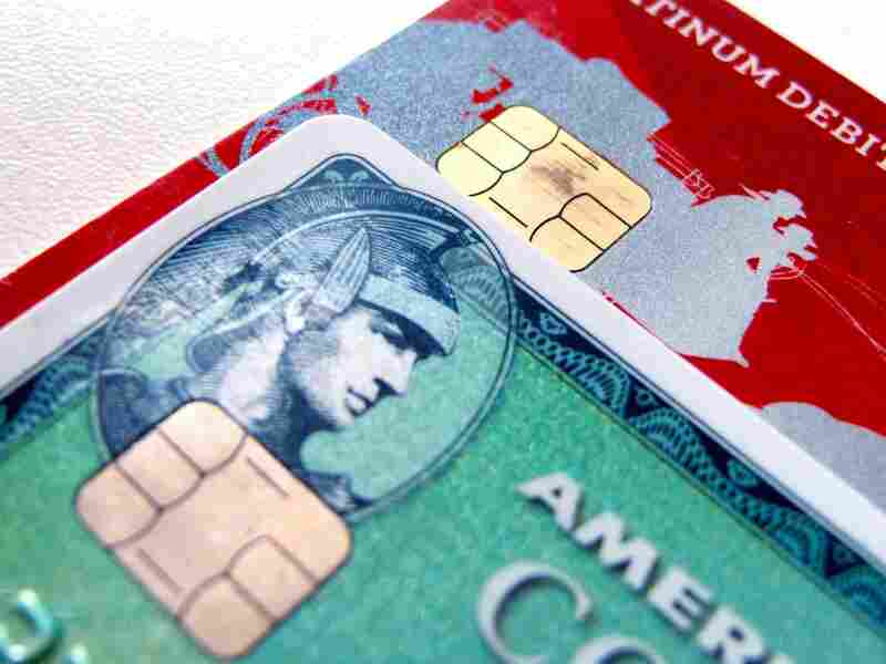 Computer chips are seen on newly-issued credit cards. In an effort to reduce counterfeiting and credit card fraud, more than 200 million payment cards have been issued with embedded computer chips in the U.S. ahead of an Oct. 1 deadline, according to the Smart Card Alliance.