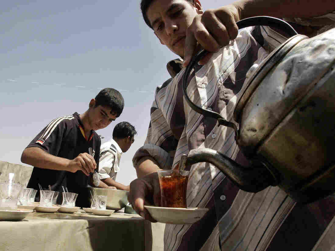 In Iraq, tea is simmered for about 15 minutes until strong and is then poured into glasses . diluted with hot water and sweetened with lots of sugar.