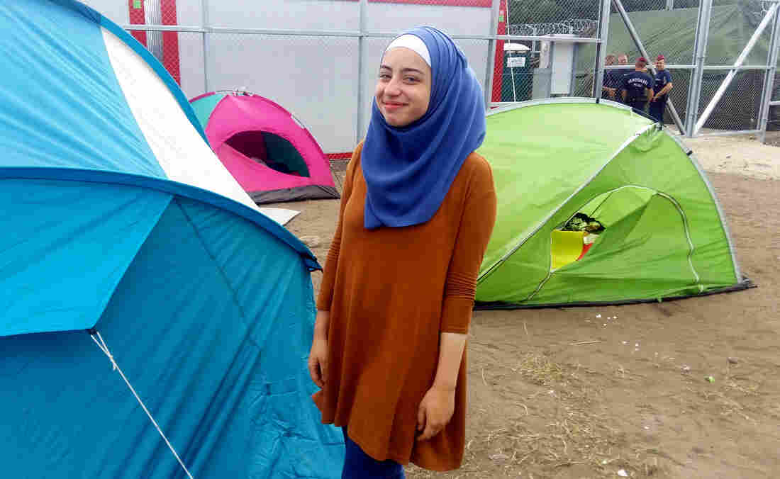 Judy al-Shtawi, 17, a Syrian refugee, waits outside a migrant detention facility in southern Hungary, near the Serbian border. She was approached by an Austrian man, offering her and her siblings a free ride to the Austrian border. Such offers are illegal — considered as smuggling — and they declined.