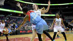 Atlanta Dream guard Angel McCoughtry (35) passes around Washington Mystics forward Ally Malott (11) in Washington, D.C., earlier this month.