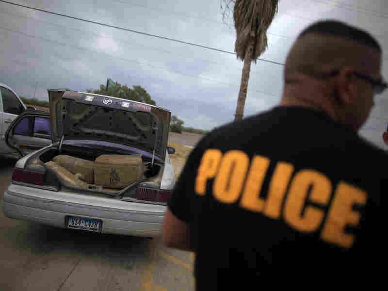 A car filled with bales of marijuana is seen at a police station in La Grulla, Texas, in 2013. A lot of drugs pass through the Border Patrol inspection station in Brooks County, where La Grulla is located; it, too, is refusing to take checkpoint cases.