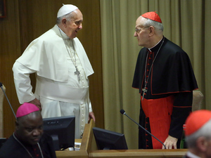 Pope Francis, shown here with Budapest's Cardinal Peter Erdo at the Vatican last year, has called on all of Europe's Catholics to take in refugees. But Erdo has said taking in refugees would amount to human trafficking.