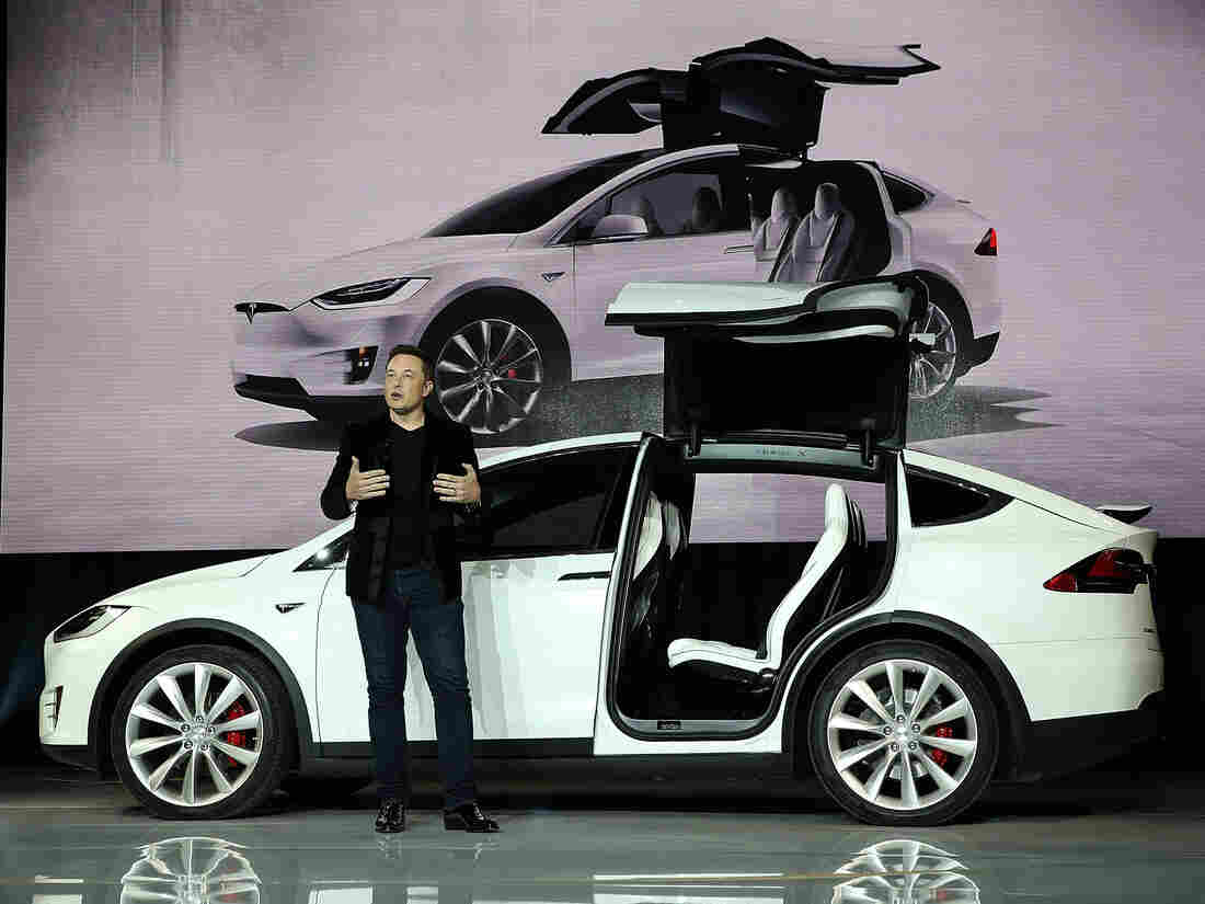 Tesla CEO Elon Musk speaks during an event in Fremont, Calif., to launch the new Tesla Model X Crossover SUV.