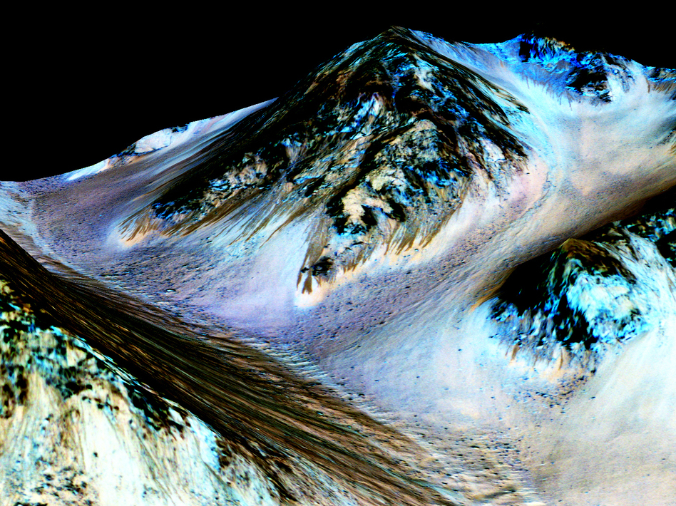 Dark, narrow streaks on Martian slopes such as these at Hale Crater are inferred to be formed by seasonal flow of water on contemporary Mars. (NASA)