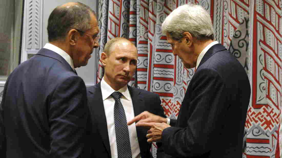 Russia has ramped up its role in Syria's civil war. Here, President Vladimir Putin (center) speaks with Secretary of State John Kerry (right) and Foreign Minister Sergei Lavrov at the U.N. General Assembly on Monday.