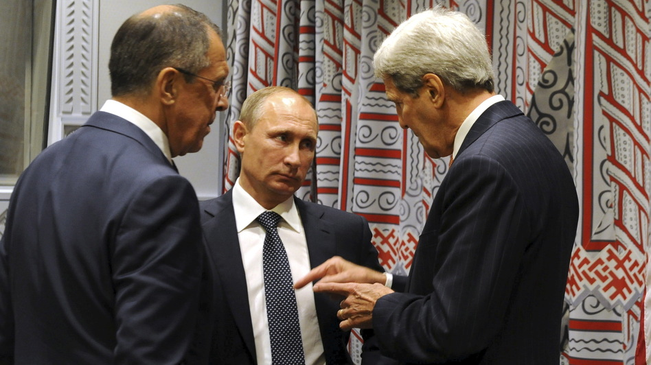 Russia has ramped up its role in Syria's civil war. Here, President Vladimir Putin (center) speaks with Secretary of State John Kerry (right) and Foreign Minister Sergei Lavrov at the U.N. General Assembly on Monday. (RIA NOVOSTI/Reuters /Landov)