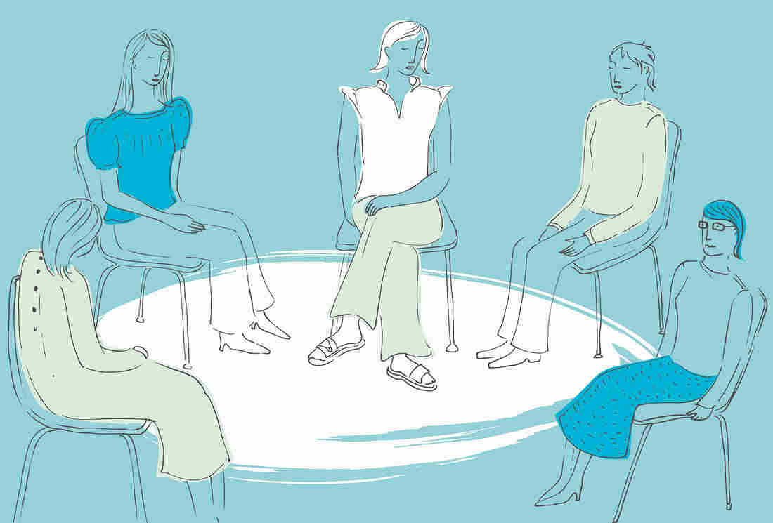 Women sitting together in a circle in a support group.