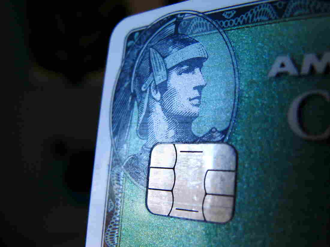 A computer chip is seen on a newly issued credit card in this photo illustration taken in Encinitas, Calif., this week. In an effort to reduce counterfeit and credit card fraud, more than 200 million payment cards have been issued with embedded computer chips in the U.S., ahead of a Oct. 1 deadline for the switch to such cards, according to the Smart Card Alliance.