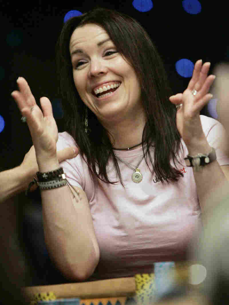 Annie Duke acknowledges applause from the audience as she is introduced for the final table of a limit Hold 'em game June 30, 2005, at the Rio Hotel and Casino in Las Vegas during the World Series of Poker.